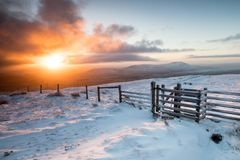 Dawn over Ingleborough, Yorkshire Dales, UK. Dawn as seen from Whernside looking across to Ingleborough on a snowy dawn Royalty Free Stock Photos