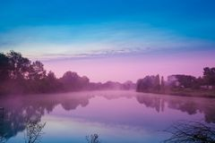 Dawn over the lake. Early in the morning, dawn over the lake. Calm lake before sunrise. A misty morning, a rural landscape, a desert, a mystical feeling Royalty Free Stock Photo