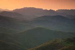 Dawn over the mountains with clouds Royalty Free Stock Photos