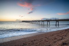Dawn at Deal Pier. Dawn over the pier at Deal, a pretty seaside town on the Kent coast Royalty Free Stock Image