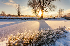 Dawn over the river in winter morning Stock Photo
