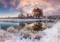 Dawn over the river in winter morning Stock Photos