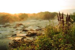 Dawn over Rushing river Stock Image