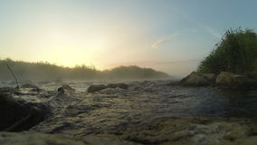 Dawn over Rushing river timelapse stock video footage