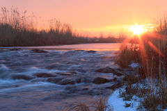Dawn over Rushing winter river stock photos
