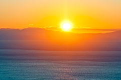 Dawn over the sea stock images