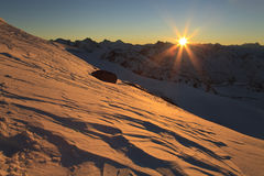 Dawn over the snow-capped mountains Stock Photo