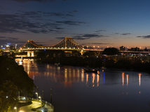 Dawn over the Story Bridge. The Story Bridge is a heritage-listed steel cantilever bridge spanning the Brisbane River that carries vehicular, bicycle and Stock Photo