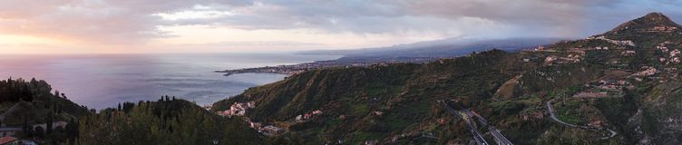 Dawn panorama of Taormina Bay in Sicily, Italy Royalty Free Stock Photography