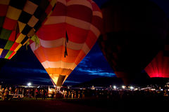 Dawn Patrol at 2015 Albuquerque Balloon Fiesta. Hot air balloons lines up in the dark before dawn, glowing in pattern for Dawn Patrol at the 2015 Albuquerque Stock Images