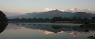 Dawn Of Phewa Lake. The fishtail reflected in Phewa Lake, Pokhara, Nepal stock photos