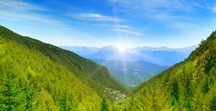 Dawn in the picturesque mountains covered with forests. Stock Photography