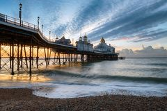 Dawn at Eastbourne. Dawn at the pier at Eastbourne on the East Sussex coast Stock Image