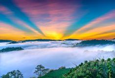 Dawn on the plateau in the morning with colorful sky,. Beneath the pine forests covered with fog shrouded the landscape so beautiful idyllic countryside Dalat Royalty Free Stock Photography