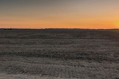 Dawn in plowed field Stock Images