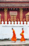 Dawn procession of monks receiving alms Stock Photo