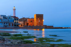 Dawn at Punta Secca Beach - Montalbano Filming Location. Dawn at Punta Secca Beach with the lighthouse and the watchtower,Torre Scalambri in Santa Croce Camerina royalty free stock photography