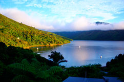 Dawn on Queen Charlotte track. Morning mist on the mountains surrounding Marlborough sound at an overnight stay on the Queen Charlotte walking trail Stock Images
