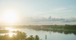 Dawn in the resort of Varadero Timelapse. Dawn in the resort of Varadero, view of the beach and palm trees swaying in the wind and the canal with yachts. Cloudy stock footage
