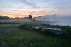 Dawn on the river bank Stock Photos