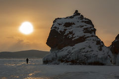 Dawn and the rock near island Lohmaty. Stock Photo
