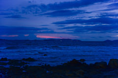 Dawn at rocky beach. With waves Stock Photos