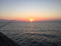 Dawn's Horizon. Atlantic Ocean dawn of a new day from the Pier Royalty Free Stock Images
