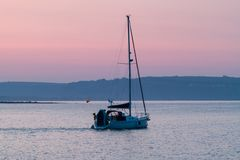 Dawn Sailing from Porthcawl Harbour stock photo