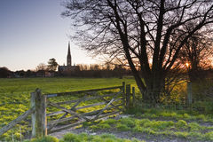 Dawn in Salisbury. A beautiful sunrise looking towards Salisbury cathedral in Wiltshire Royalty Free Stock Photography