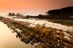 Dawn at Sea and Coral. Serenity and peaceful Morning at Sawarna Beach, Indonesia Royalty Free Stock Photo