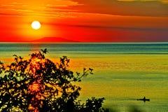 Dawn at sea. Coast summer at times Stock Photography