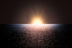 Dawn at sea. Dawn with bright sun at sea with waves Stock Image