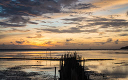 Dawn at the seaside when low tide Stock Photo