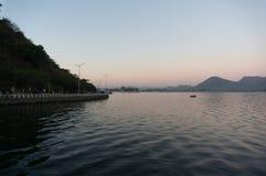 Dawn shot of Fateh Sagar lake udaipur India. Serene dawn shot of Fateh sagar lake udiapur india. This famous tourist destination of India invites locals and Stock Photos