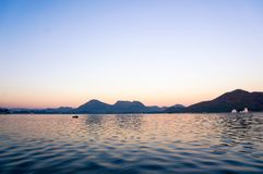 Dawn shot of Fateh Sagar lake udaipur India. Serene dawn shot of Fateh sagar lake udiapur india. This famous tourist destination of India invites locals and Royalty Free Stock Photo