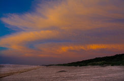 Dawn sky on beach. Pink and yellow clouds over dawn beach at Mablethorpe,Lincolnshire Royalty Free Stock Photography