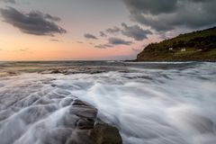 Dawn sky rock flows Garie Beach Stock Image
