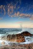 Dawn sky sea of silence. Storm waves crash on a rock in the early morning on the ocean coast Stock Images