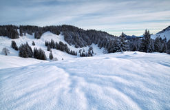 Dawn in snowy mountains Royalty Free Stock Photos