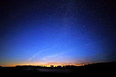 Dawn on a starry background sky and  Milky Way. Royalty Free Stock Photography