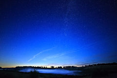 Dawn on  starry background sky and the Milky Way. Royalty Free Stock Photo