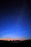 Dawn on starry background sky and the Milky Way. Stock Photo
