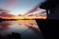 Dockside Harbor Morning, Steveston. Dawn in Steveston Harbor, British Columbia, Canada where the commercial fishing fleet waits for the fishing season to open Stock Image