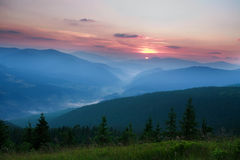 Dawn sun rise early in the morning in a mountain valley Stock Images
