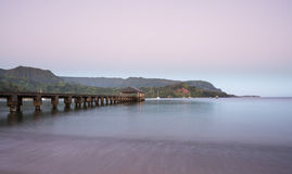 Dawn and sunrise at  Hanalei Bay and Pier on Kauai Hawaii Royalty Free Stock Photo