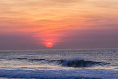 Dawn Sunrise Ocean Horizon. Dawn Sunrise colors of new day over the ocean horizons waves beach landscape Royalty Free Stock Images
