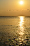 Dawn, sunrise, sun, sea, nature, water, landscape. Landscape. Sunrise over the sea. Yellow reflection in the water Stock Images