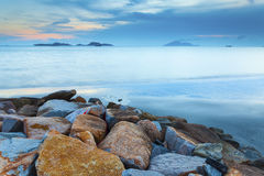 Dawn sunset landscape over beautiful rocky coastline Stock Image