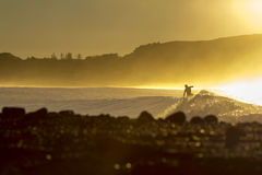 Dawn surfer. Dawn surfing, with quality waves and stunning morning. Location New Zealand, Kaikoura at the Kahutara surf break Stock Photo