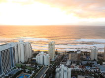Sunrise over city by the sea aerial image Royalty Free Stock Photography